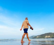 Retired-Male-Senior-Walking-Beach-Shore-Man-Sea